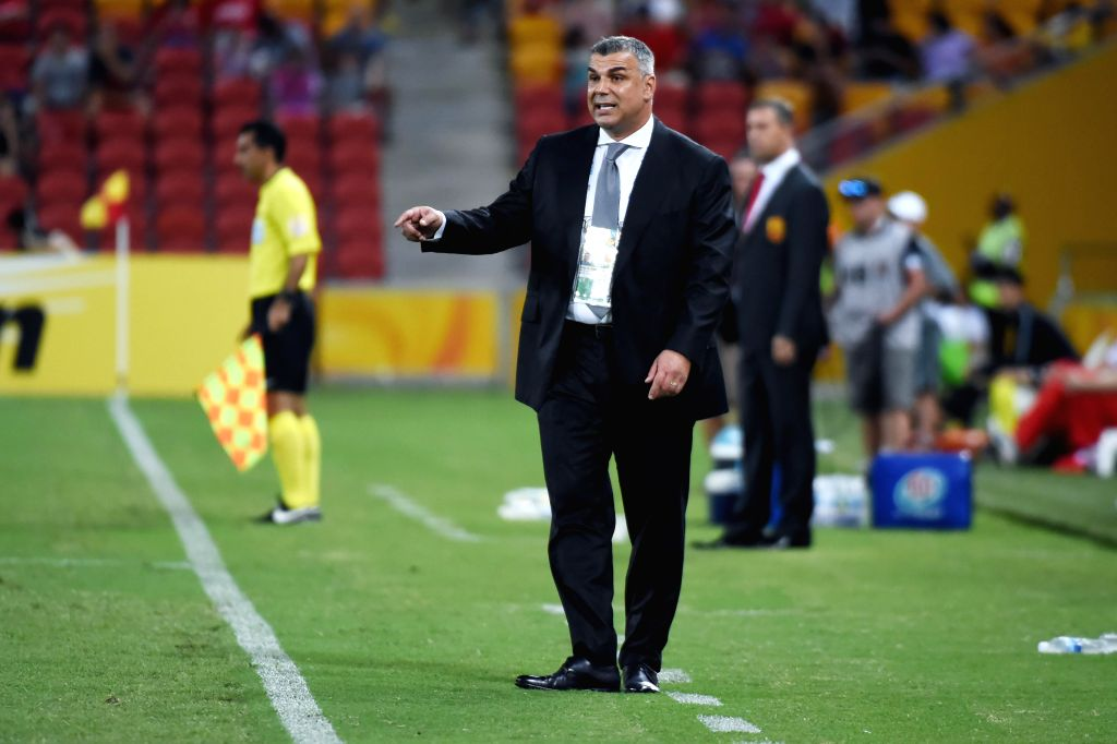 Head coach of Saudi Arabia Mirdjalal Kasimov (front) gestures during a Group B match against China at the AFC Asian Cup in Brisbane, Australia, Jan. 10, 2015. ...