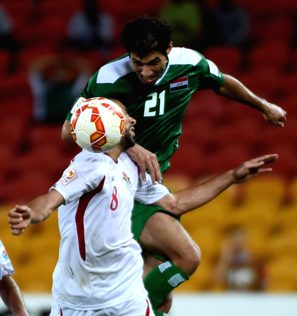 Saad Abdulameer Al-Dobjahawe (R) of Iraq vies with Saeed Murjan of Jordan during a Group D match at the AFC Asian Cup in Brisbane, Australia, Jan. 12, 2015. Iraq ..