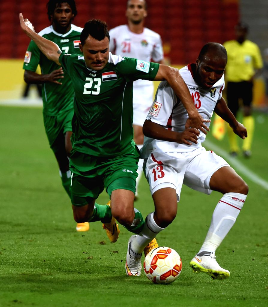Waleed Salim Al-Lami (L front) of Iraq vies with Khalil Baniateyah of Jordan during a Group D match at the AFC Asian Cup in Brisbane, Australia, Jan. 12, 2015. ...
