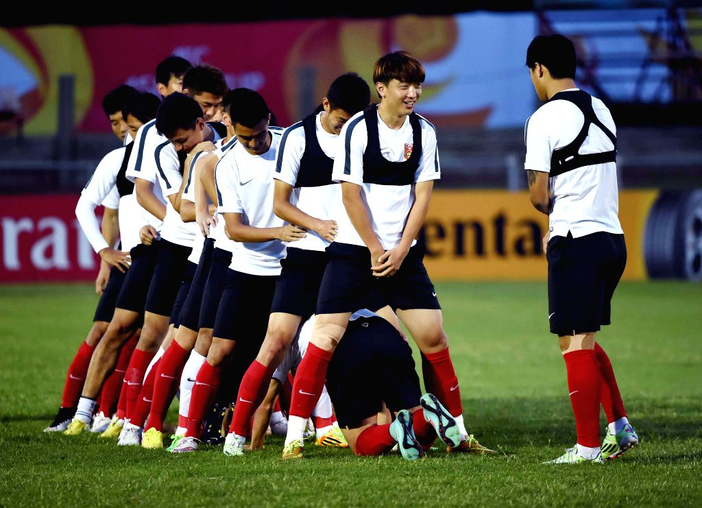 Chinese football team attends a training session prior to the group match against Uzbekistan at the AFC Asian Cup in Brisbane, Australia, Jan. 13, 2015. ...