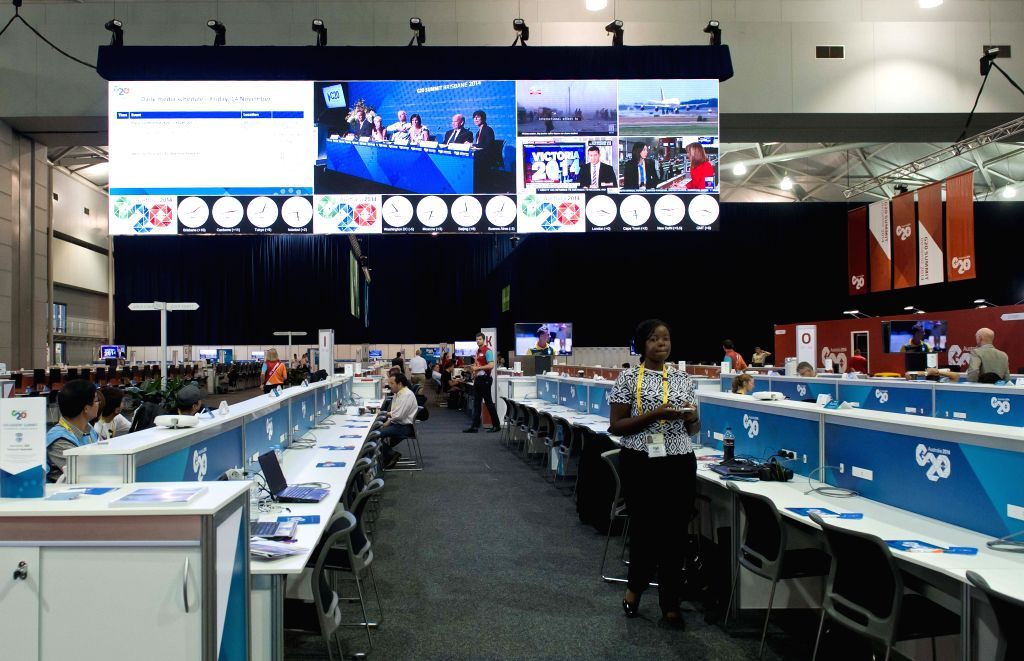 Reporters work at the international media center in the Brisbane Convention and Exhibition Center in Brisbane, Australia, on Nov. 14, 2014. The G20 summit will be held on Nov. 15-16 in ...
