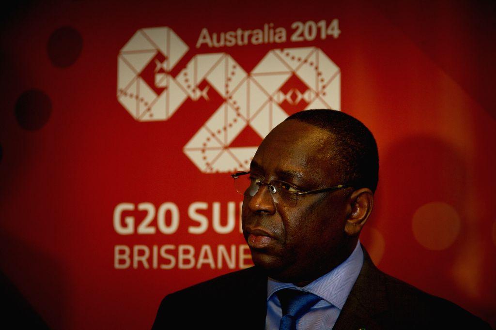 Senegal's President Macky Sall arrives in Brisbane of Australia to attend the G20 summit on Nov. 14, 2014.