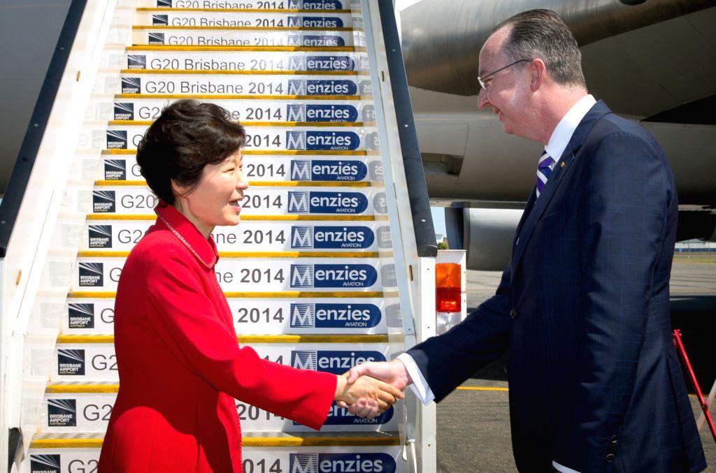 South Korean President Park Geun-hye (L) arrives in Brisbane of Australia to attend the G20 summit on Nov. 14, 2014.