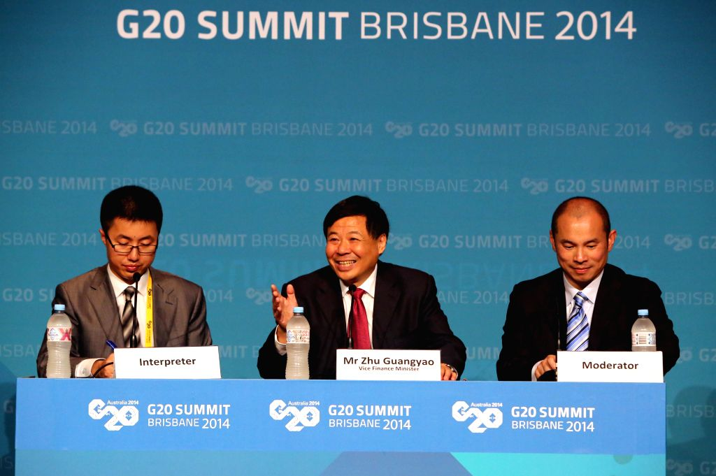 Zhu Guangyao(C), China's Vice Finance Minister, attends Chinese delegation's press conference at the G20 Summit in Brisbane, Australia, on Nov. 15, 2014.