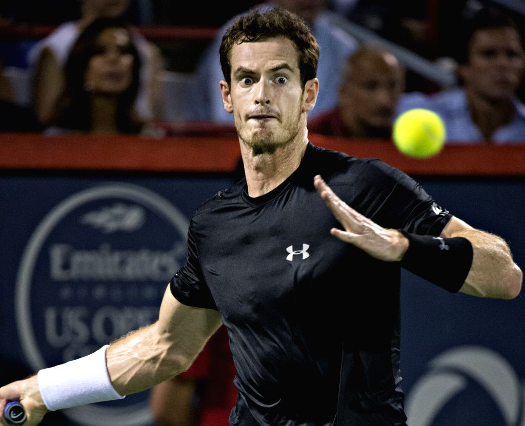 Britain's Andy Murray returns the ball against Japan's Kei Nishikori during their semifinal match of men's singles at the 2015 Rogers Cup in Toronto, Canada, August ...