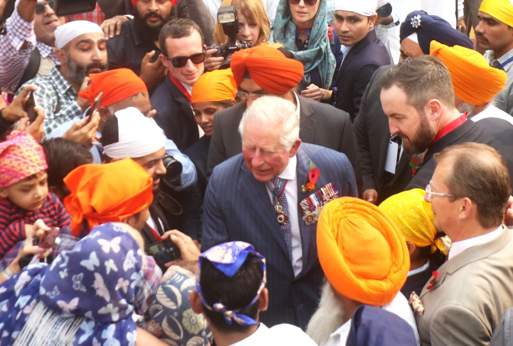 Britain's Prince Charles interacts with devotees at Sri Bangla Sahib Gurudwara during the 550th birth anniversary celebrations of Guru Nanak Dev, in New Delhi on Nov 13, 2019. - Nanak Dev