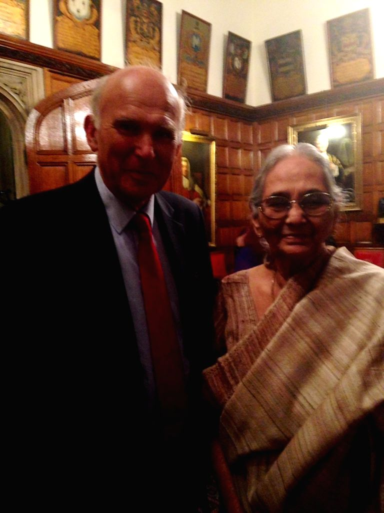 Britain's Secretary of State for Business, Innovation & Skills, Vince Cable with Roma Ray, daughter of Indian freedom fighter Sarat Chandra Bose at a lecture organised to mark Bose's 125th birth .