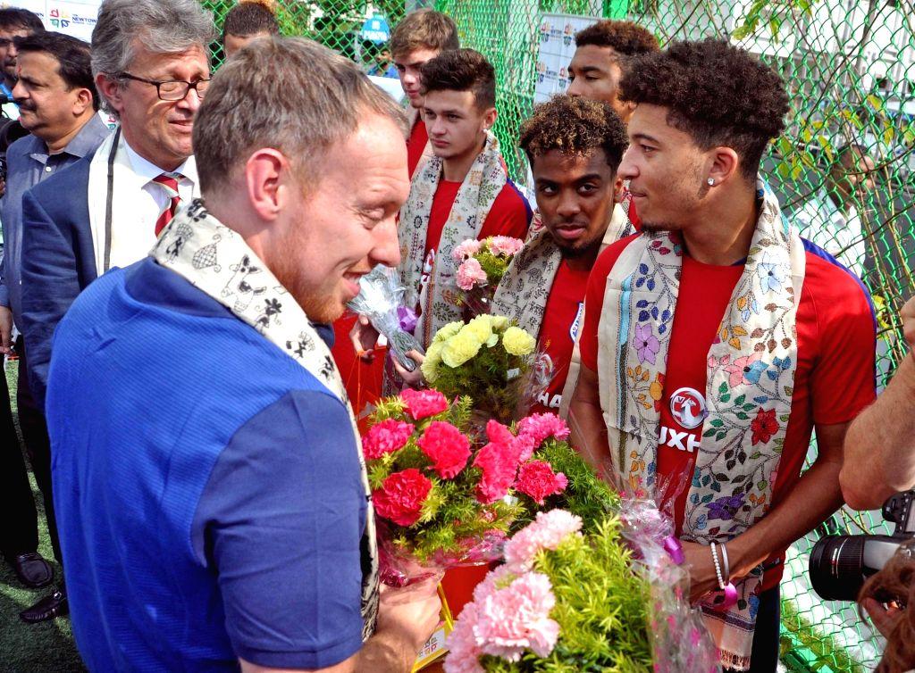 British Deputy High Commissioner in Kolkata, Bruce Bucknell, FIFA U-17 England coach Steve Cooper, English footballers Jadon Sancho, Angel Gomes, Joel Latibeaudiere in Kolkata on Oct 12, ...