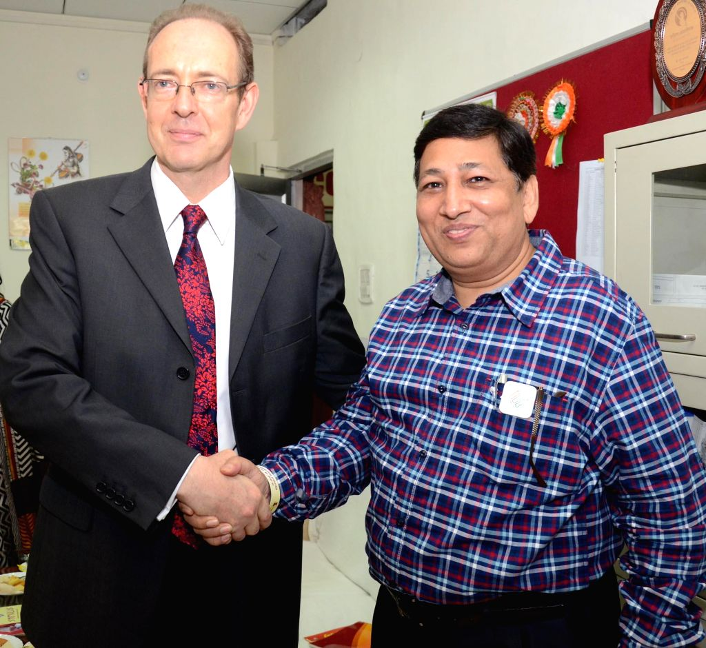 British High Commissioner to India, James Bevan with Chief Electoral Officer Umesh Sinha during a meeting in Lucknow on April 30, 2014.