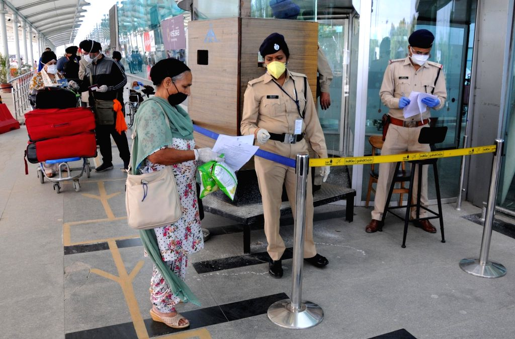 British nationals stand in a queue before they check-in to board a special British Airways flight at Sri Guru Ram Dass Jee International Airport in Amritsar amid the nationwide lockdown ...