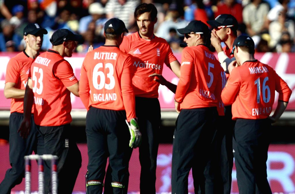 British players celebrate after defeating India in the lone T20 match played at Edgbaston, Birmingham, England on Sept 7, 2014.
