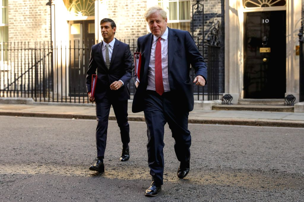 British Prime Minister Boris Johnson (R) and Britain's Chancellor of the Exchequer Rishi Sunak (L) leave 10 Downing Street for a cabinet meeting in London, Britain, ... - Boris Johnson