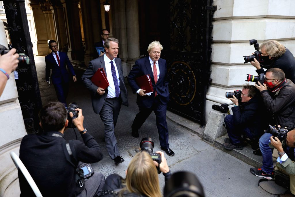 British Prime Minister Boris Johnson (R, center) returns to Downing Street following a cabinet meeting, in London, Britain, on Sept. 1, 2020. - Boris Johnson