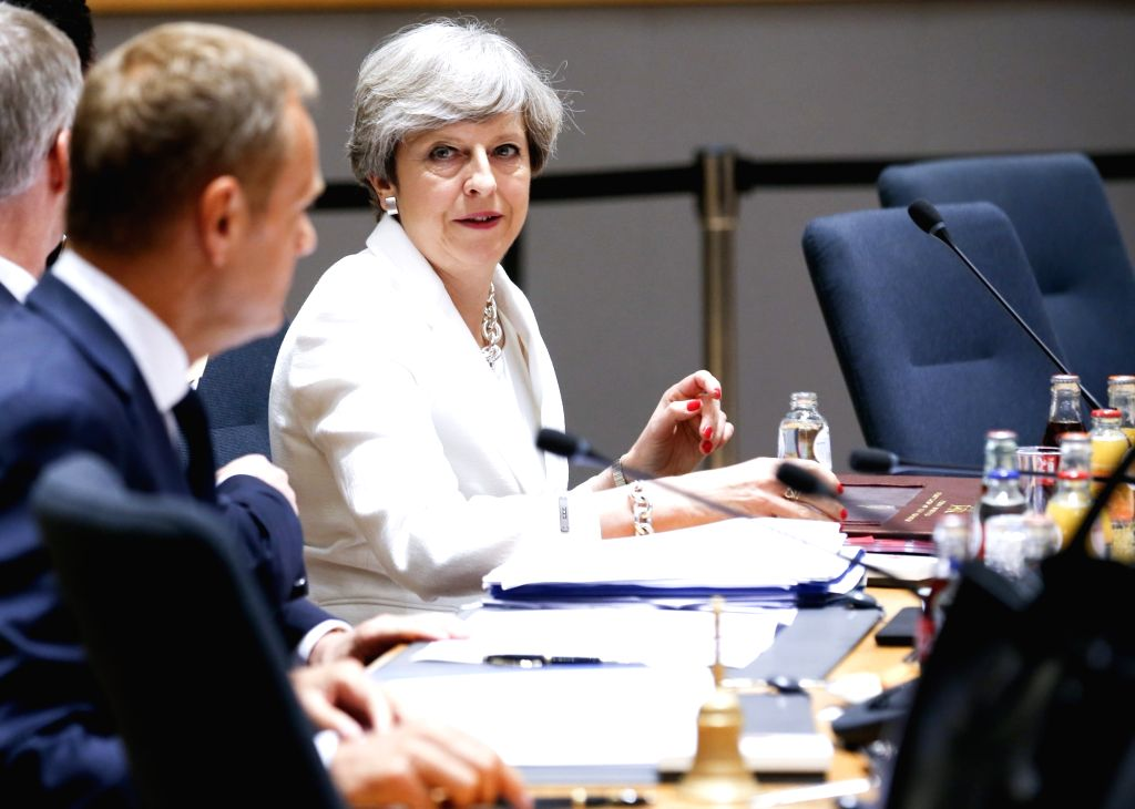 British Prime Minister Theresa May (R) attends the second day of EU Summit in Brussels, Belgium, June 23, 2017. - Theresa May