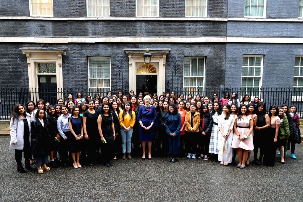 British Prime Minister Theresa May with the winners of 70th Anniversary Scholarship programme, in London on Nov 2, 2018. British Council, the United Kingdom's international organisation for ... - Theresa May