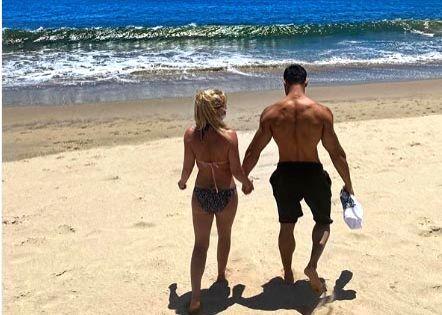 Britney Spears goes on beach date in mask and bikini.