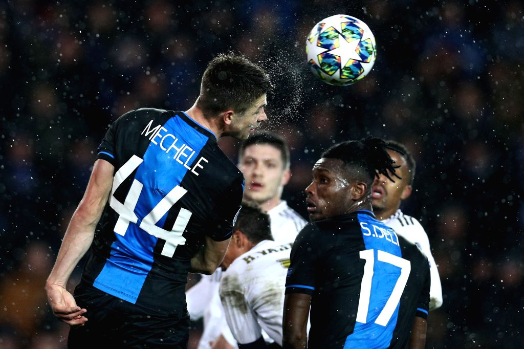 BRUGGE, Dec. 12, 2019 - Brandon Mechele (L) of Club Brugge clears the ball with a header during a Group A match of the 2019-2020 UEFA Champions League between Club Brugge and Real Madrid in Brugge, ...