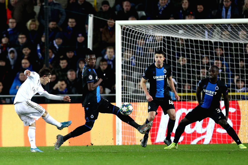 BRUGGE, Dec. 12, 2019 - Luka Modric (1st L) of Real Madrid shoots the ball during a Group A match of the 2019-2020 UEFA Champions League between Club Brugge and Real Madrid in Brugge, Belgium, Dec. ...