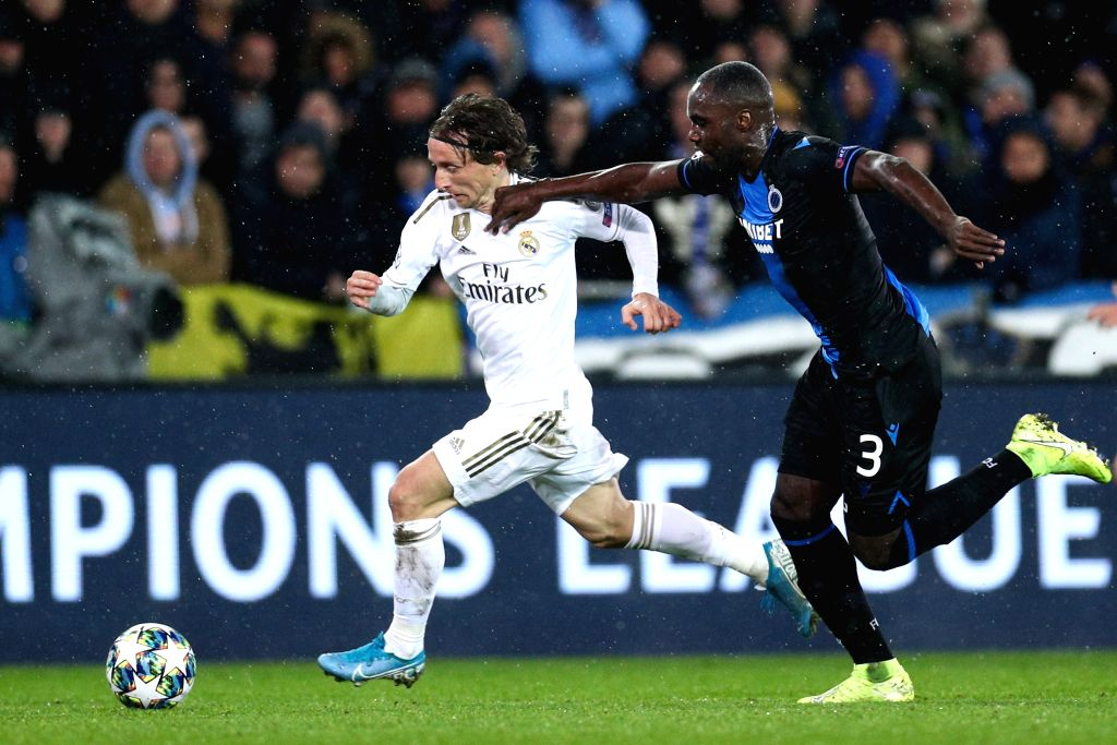 BRUGGE, Dec. 12, 2019 - Luka Modric (L) of Real Madrid drives the ball during a Group A match of the 2019-2020 UEFA Champions League between Club Brugge and Real Madrid in Brugge, Belgium, Dec. 11, ...