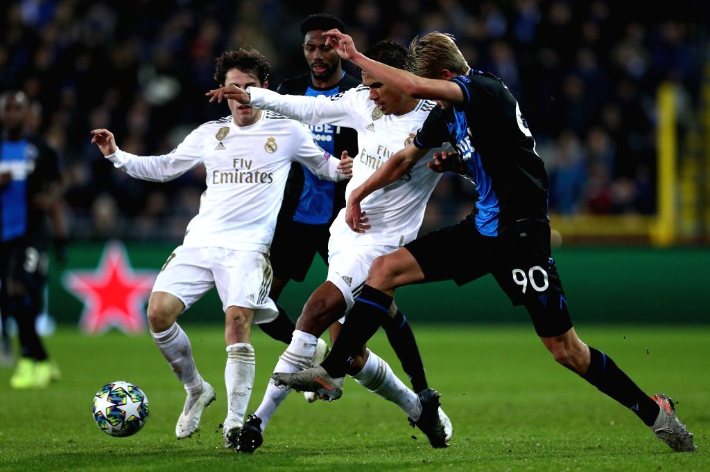BRUGGE, Dec. 12, 2019 - Raphael Varane (2nd R) of Real Madrid vies with Charles De Ketelaere (1st R) of Club Brugge during a Group A match of the 2019-2020 UEFA Champions League between Club Brugge ...