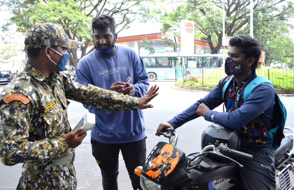 Bruhat Bengaluru Mahanagara Palike (BBMP) Marshals intercept commuters during a strict lockdown that has been re-imposed for 15 days in five wards across Bengaluru to contain the spread of ...