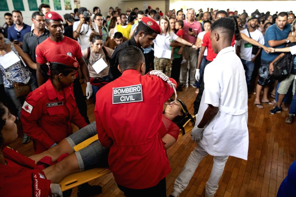 BRUMADINHO, Jan. 27, 2019 - Medical staff help a faint woman in a helping center near Brumadinho, the state of Minas Gerais, Brazil, on Jan. 26, 2019. At least 34 people were killed after a tailings ...
