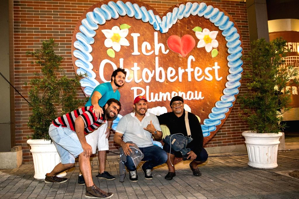 BRUMENAU (BRAZIL), Oct. 5, 2017 Men pose for photograph at the Oktoberfest of Blumenau 2017 in Blumenau, Brazil, on Oct. 4, 2017. The Oktoberfest of Blumenau, considered as the the ...