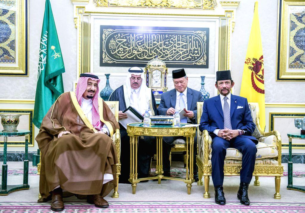 Brunei's Sultan Haji Hassanal Bolkiah (1st R) meets with visiting Saudi King Salman bin Abdul Aziz al Saud (1st L) at the Istana Nurul Iman palace in ...