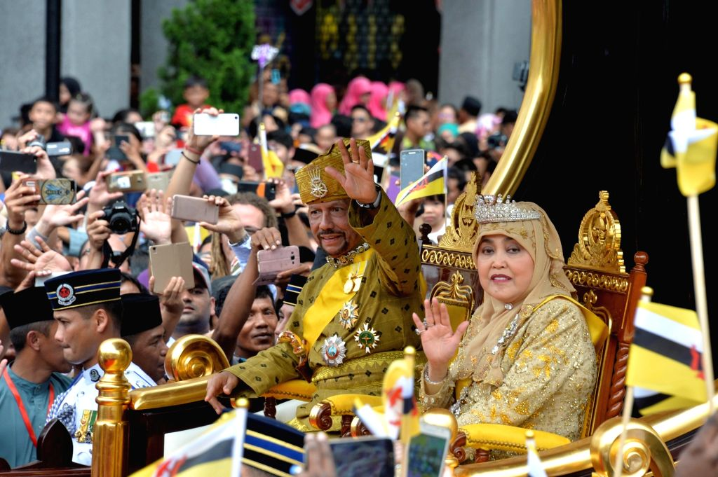 Brunei's Sultan Haji Hassanal Bolkiah (2nd R, Front) waves to the crowd during a Royal Procession in Bandar Seri Begawan, capital of Brunei, on Oct. 5, ...