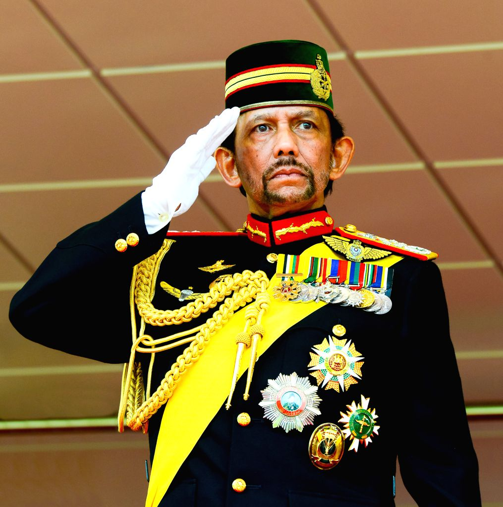 Brunei's Sultan Haji Hassanal Bolkiah salutes back to the parading people during a ceremonial parade held for his 72nd birthday celebration in Bandar ...