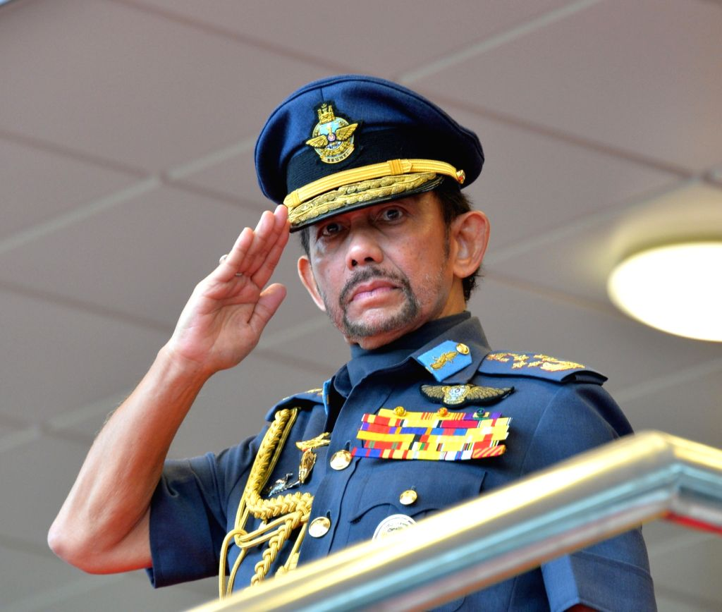 Brunei's Sultan Haji Hassanal Bolkiah salutes to the parading contingents during the 35th National Day celebration in Bandar Seri Begawan, capital of ...