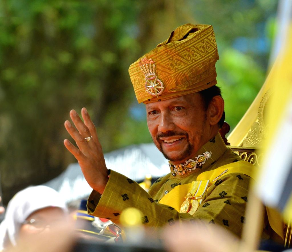 Brunei's Sultan Haji Hassanal Bolkiah waves to the crowd during a Royal Procession in Bandar Seri Begawan, capital of Brunei, on Oct. 5, 2017. Brunei ...