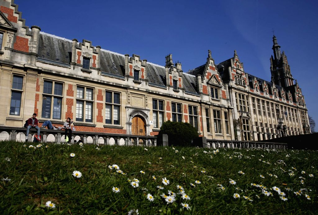 Some students enjoy sunshine at the campus of Free University of Brussels, Belgium, April 14, 2015. The daily highest temperature of Brussels reached about 24 ...