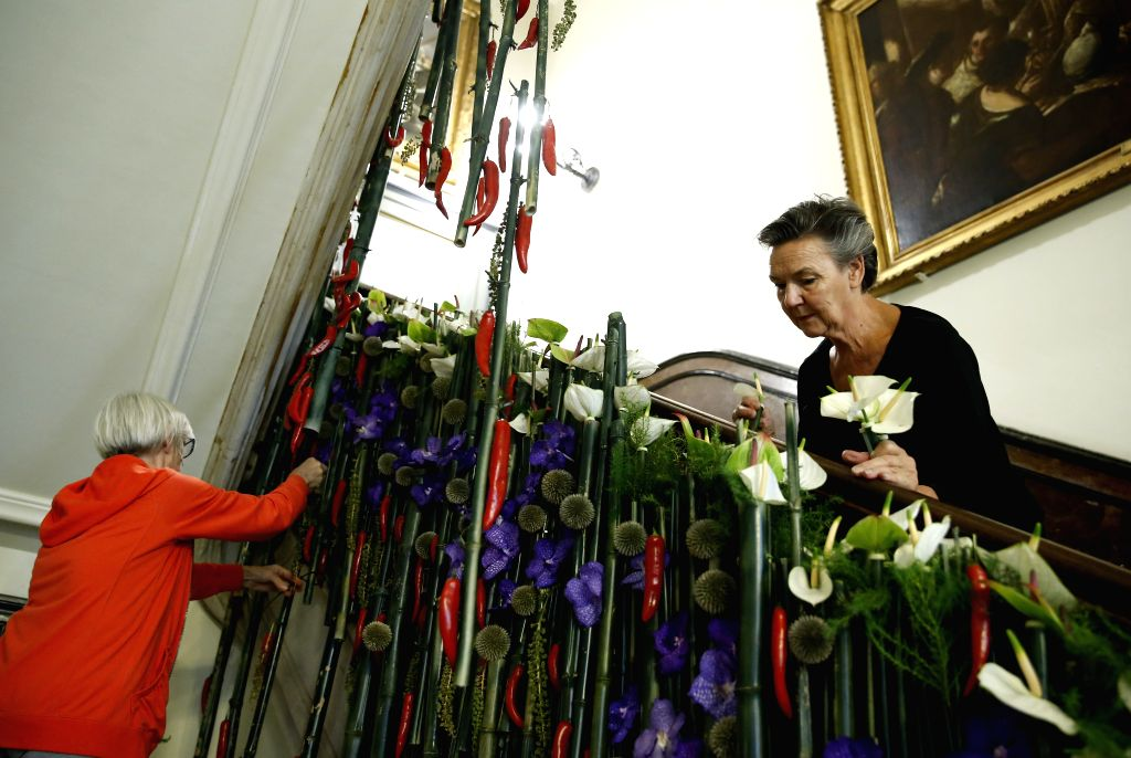 BRUSSELS, Aug. 10, 2017 - Florists decorate a floral work at Brussels city hall in Brussels, Belgium, Aug. 10, 2017. The flowertime of Brussels city hall will be held on Aug. 11, and last for five ...