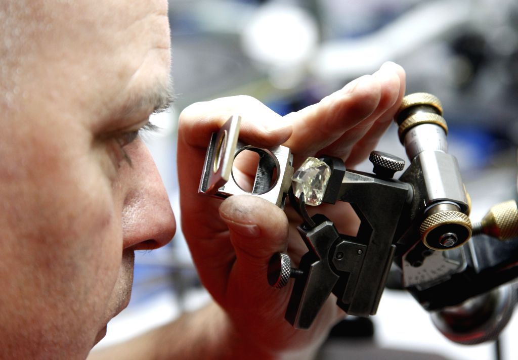 Brussels (Belgium): A technician watches the condition of a diamond in Antwerp, Belgium, Nov. 7, 2014. Antwerp is a world diamond trade center where 84 percent of the world's rough diamonds and 50 ...