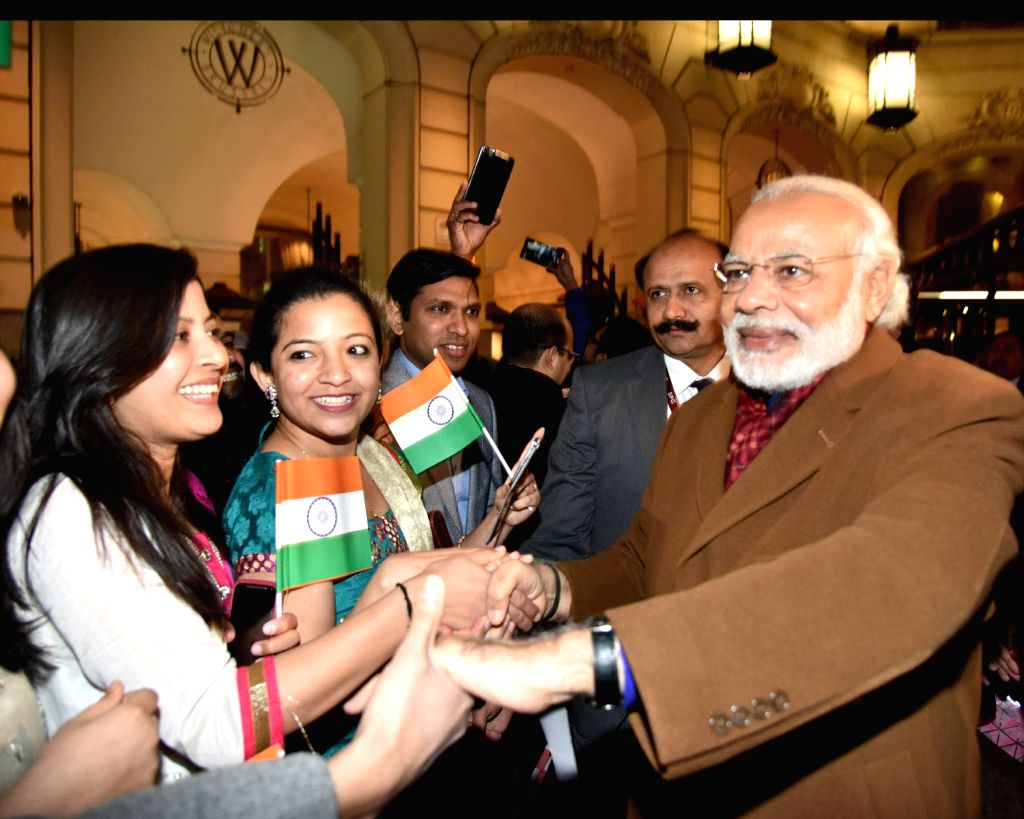 Brussels (Belgium): Prime Minister Narendra Modi being warmly welcomed by the people of Indian Community, on his arrival at Brussels, Belgium on March 30, 2016. - Narendra Modi