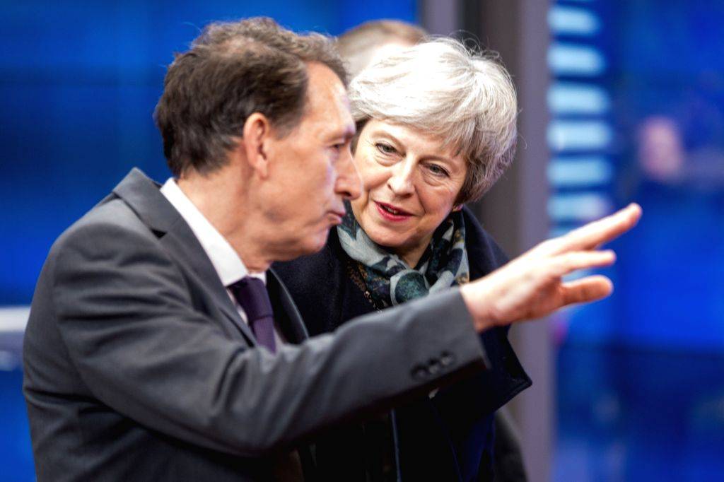 BRUSSELS, Dec. 11, 2018 - British Prime Minister Theresa May (R) arrives at the European Council in Brussels, Belgium, on Dec. 11, 2018. Theresa May launched her mission Tuesday to attempt to rescue ... - Theresa May