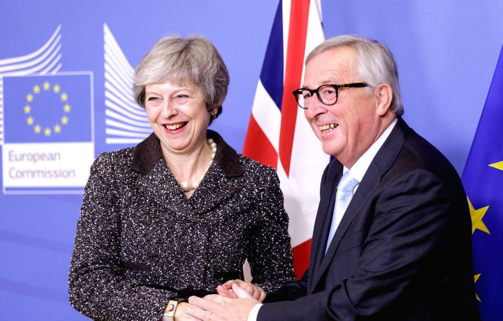 BRUSSELS, Dec. 11, 2018 - British Prime Minister Theresa May (L) shakes hands with European Commission President Jean-Claude Juncker during their meeting to discuss Brexit at the EU headquarters in ... - Theresa May