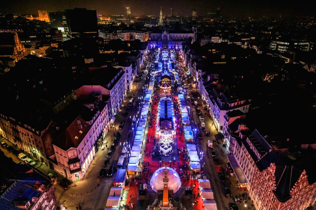 BRUSSELS, Dec. 12, 2018 - A Christmas market is seen in central Brussels, Belgium, on Dec. 12, 2018. More than 200 chalets and fairground attractions at the Christmas market attract visitors here in ...