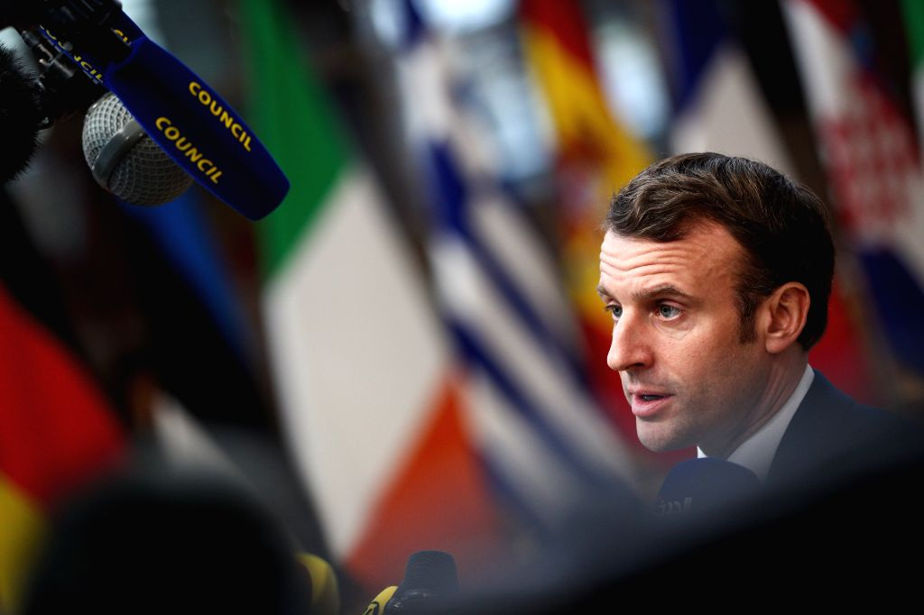 BRUSSELS, Dec. 12, 2019 - French president Emmanuel Macron speaks to the media before the EU summit at the EU headquarters in Brussels, Belgium, Dec. 12, 2019. During the two-day meetings, leaders of ...