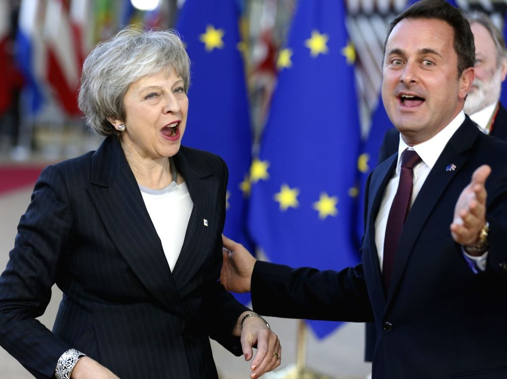 BRUSSELS, Dec. 13, 2018 - British Prime Minister Theresa May (L) and Prime Minister of Luxembourg Xavier Bettel arrive at a two-day EU summit in Brussels, Belgium, Dec. 13, 2018. - Theresa May