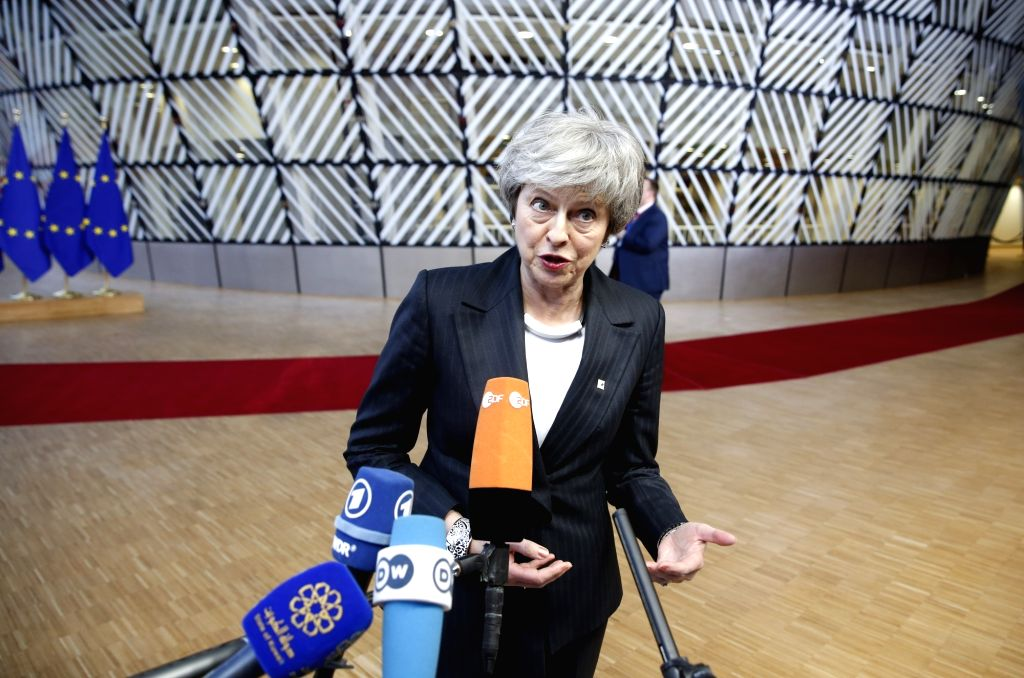 BRUSSELS, Dec. 13, 2018 - British Prime Minister Theresa May speaks to the media upon arrival at a two-day EU summit in Brussels, Belgium, Dec. 13, 2018. - Theresa May