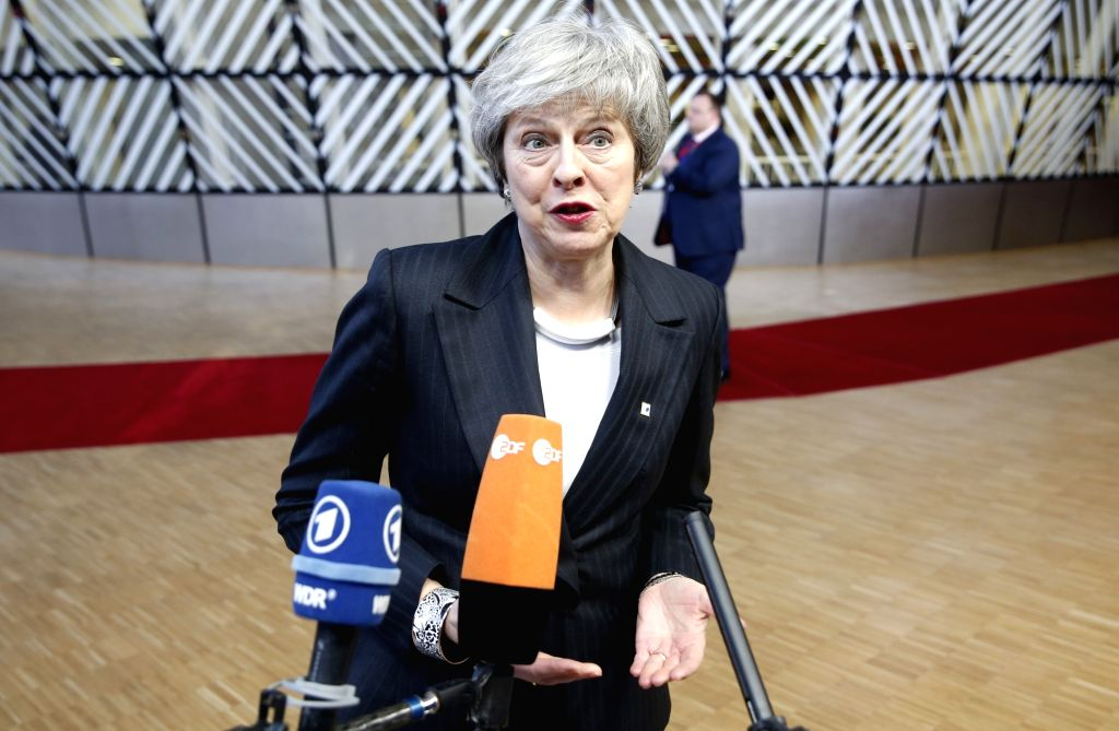 BRUSSELS, Dec. 13, 2018 - British Prime Minister Theresa May speaks to media upon her arrival at a two-day EU Summit in Brussels, Belgium, Dec. 13, 2018. - Theresa May