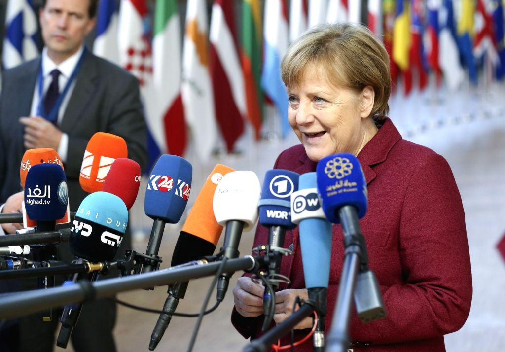 BRUSSELS, Dec. 13, 2018 - German Chancellor Angela Merkel speak to media upon her arrival at a two-day EU Summit in Brussels, Belgium, Dec. 13, 2018.