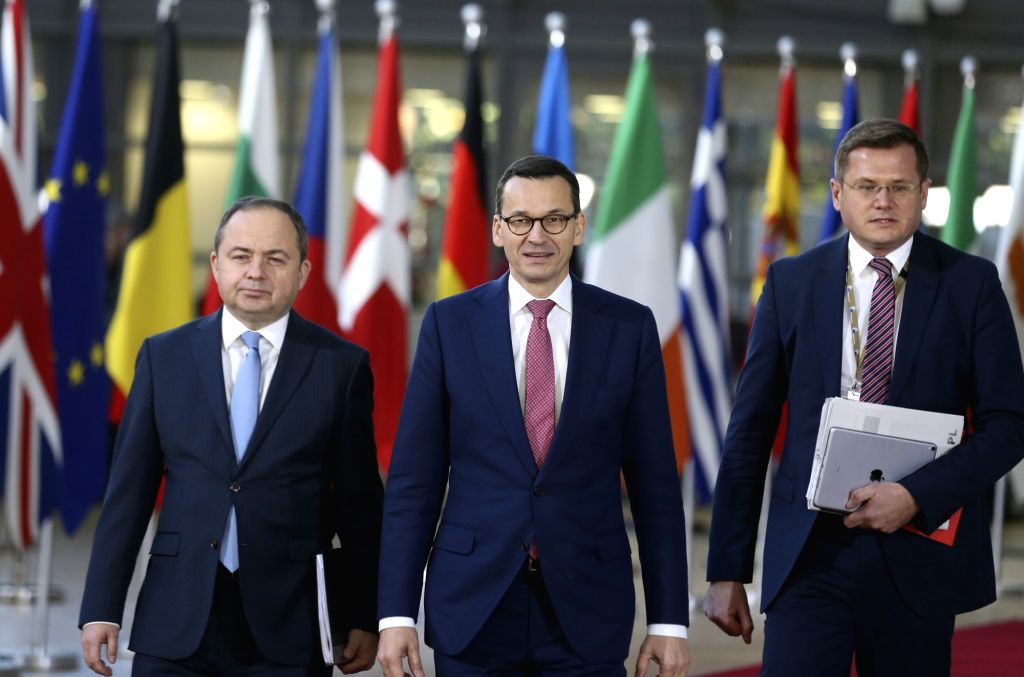 BRUSSELS, Dec. 13, 2018 - Polish Prime Minister Mateusz Morawiecki (C) arrives at a two-day EU summit in Brussels, Belgium, Dec. 13, 2018. - Mateusz Morawiecki