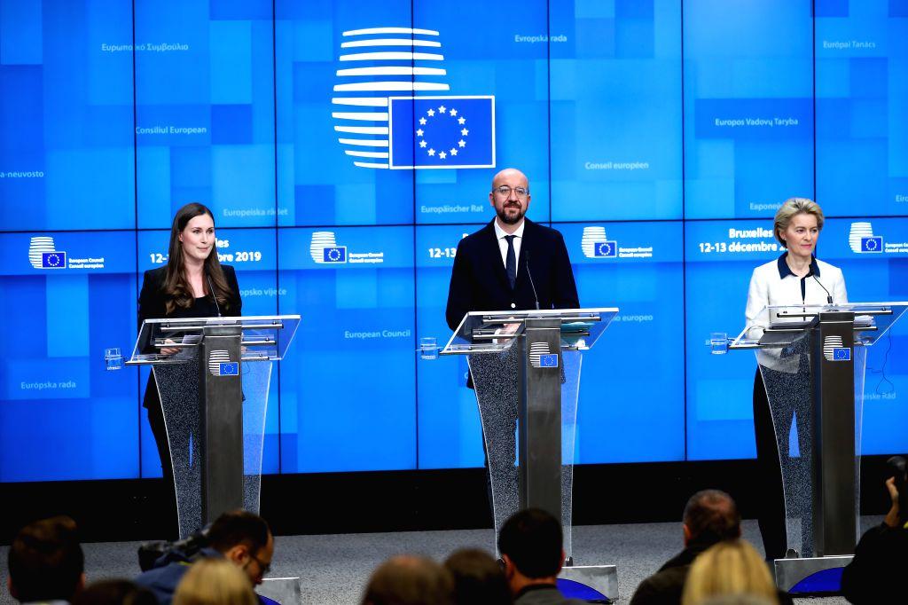 BRUSSELS, Dec. 13, 2019 - European Council President Charles Michel (C), European Commission President Ursula Von Der Leyen (R) and Finnish Prime Minister Sanna Marin attend a press conference at the ... - Sanna Marin