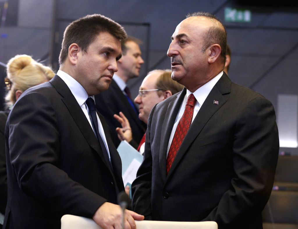 BRUSSELS, Dec. 4, 2018 - Turkish Foreign Minister Mevlut Cavusoglu (R in front) talks with his Ukrainian counterpart Pavlo Klimkin during the NATO foreign ministers meeting in Brussels, Belgium, on ... - Mevlut Cavusoglu