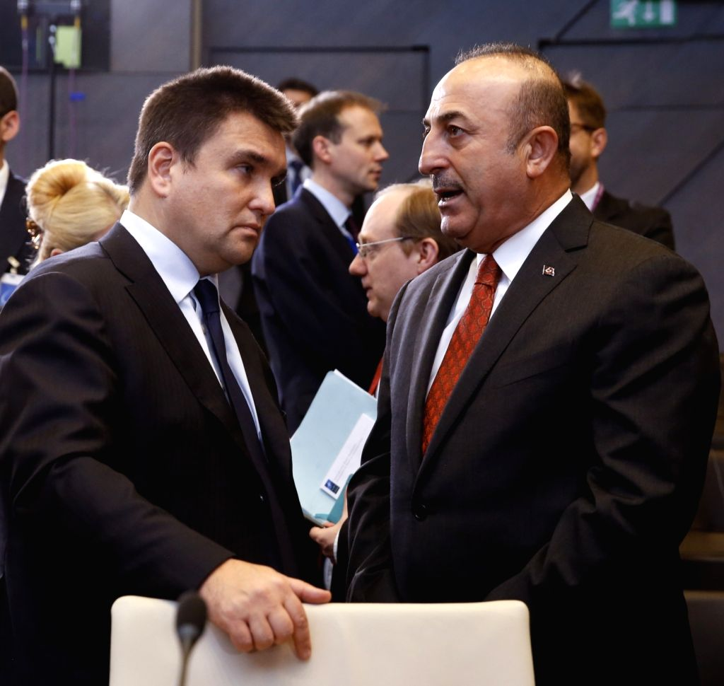 BRUSSELS, Dec. 4, 2018 - Turkish Foreign Minister Mevlut Cavusoglu (R) talks with his Ukrainian counterpart Pavlo Klimkin during the NATO foreign ministers meeting in Brussels, Belgium, on Dec. 4, ... - Mevlut Cavusoglu