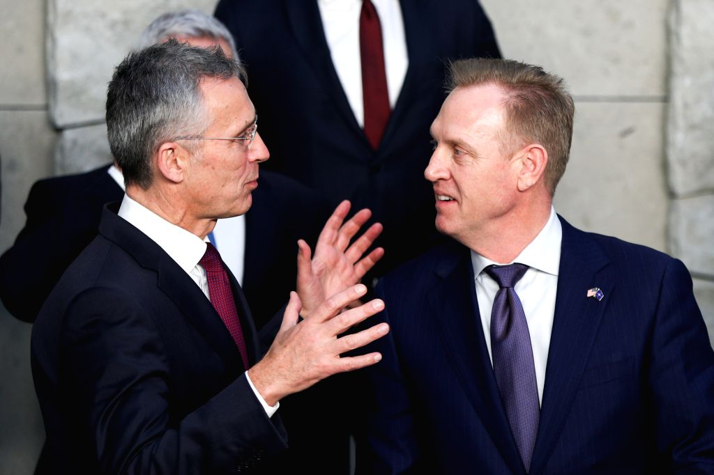 BRUSSELS, Feb. 13, 2019 - NATO Secretary General Jens Stoltenberg (L) speaks with acting U.S. Secretary of Defense Patrick Shanahan during the NATO defense ministers meeting at the NATO headquarters ...
