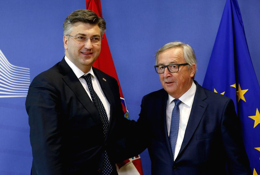 BRUSSELS, Feb. 14, 2018 - European Commission President Jean-Claude Juncker (R) meets with Croatian Prime Minister Andrej Plenkovic at EU headquarters in Brussels, Belgium, Feb. 14, 2018. - Andrej Plenkovic